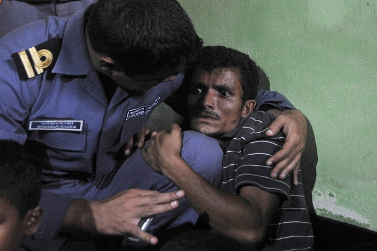 SCARED: A Rohingya Muslim from Myanmar who crossed the Naf River to escape sectarian violence at home was comforted at a Bangladesh Coast Guard station Tuesday in Teknaf, Bangladesh, before he was sent back to Myanmar. (Agence France-Presse/Getty Images)