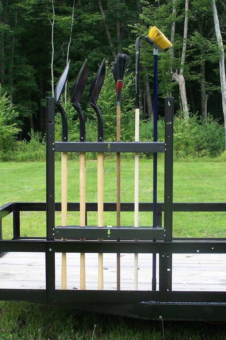 Open Trailer Shovel & Long Handled Tool Rack by Pack'em Racks. Holds 6 straight-handle shovels, brooms or rakes. Designed for use on open, flatbed trailers. Consists of 2 brackets with holes for tool handles to slip into. Constructed of sturdy steel. Finish is gray powder coat for corrosion resistance.