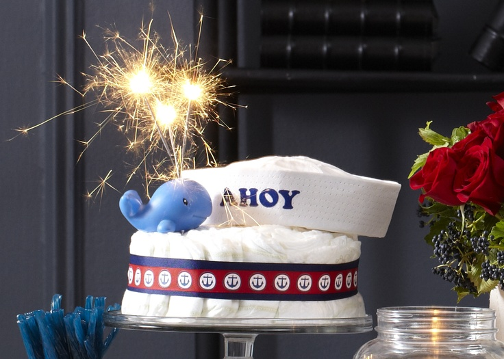 Ahoy Baby diaper cake. Single-tiered diaper cake with 100 HUGGIES® Pure & Natural diapers, baby whale and Ahoy cap topper.