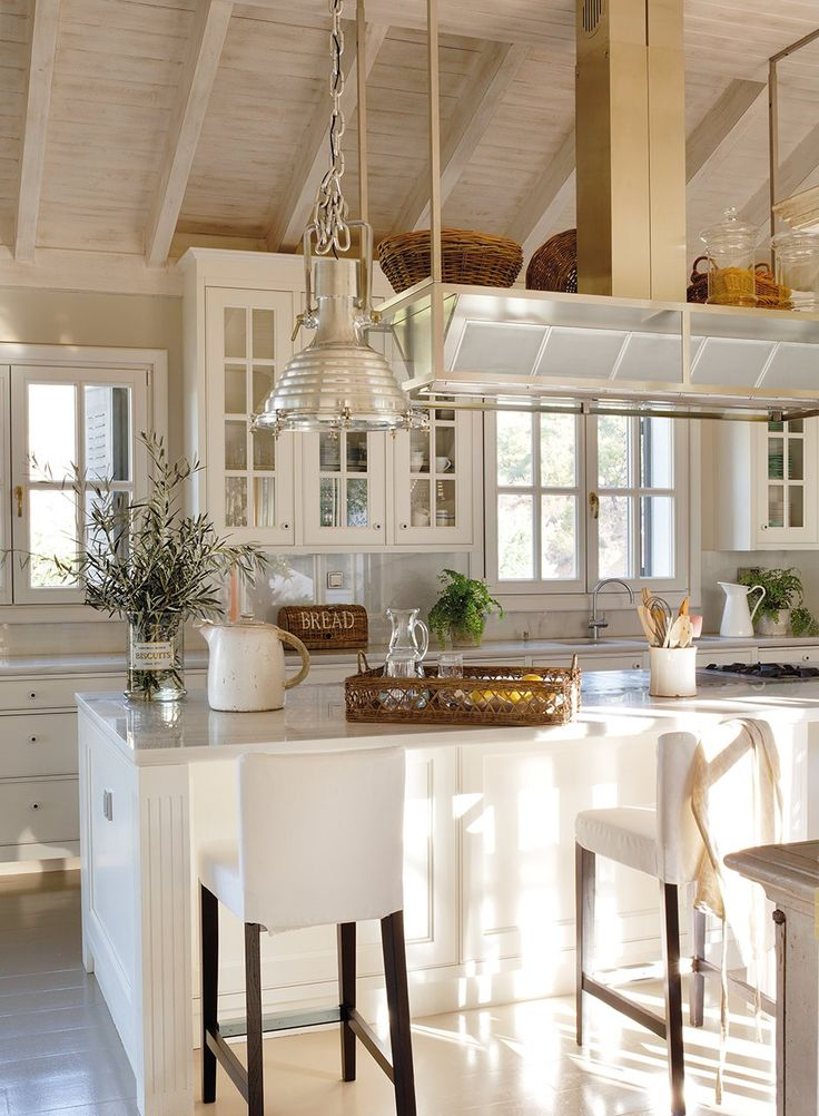 Bright coastal kitchen, marble, painted floors and wood beams...