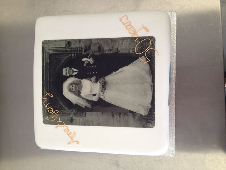 A very personal 50th wedding anniversary cake with edible wedding photo
