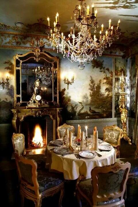 sophisticated table, painted walls, candles and chandelier