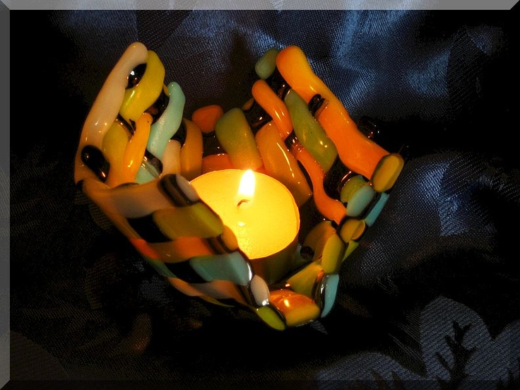 woven 90 Coe Bullseye art-glass in opal colors and strips.  Little cute candle-holder.