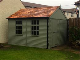premium quality peebles sheds and workshops can be treated in sadolin and topped with a ceda shingle roof