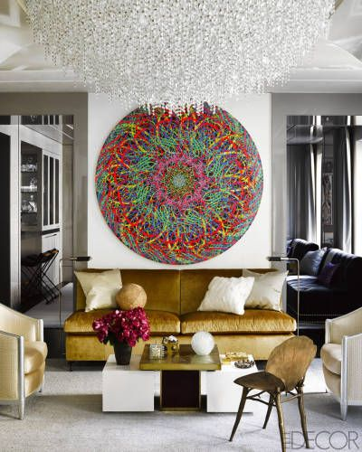 A painting by Ryan McGinness hangs above a custom-made banquette covered in a Pollack velvet; the cocktail table is by Willy Daro, the bronze chair is by Claude Lalanne, and the ceiling fixture is a custom design.