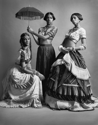 Gavin Fernandes's 2007 exhibition: 'Empire Line' and 'Monarchs of the East End'; he's a Senior Lecturer for Fashion Photography at London College of Fashion. His models have just the right 19th, early 20th century studio potrait expressions too