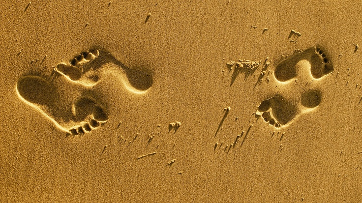 Footsteps in the wet sand