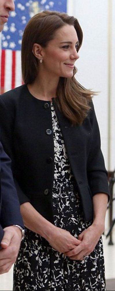 Who made  Kate Middleton's black jacket and white print dress?