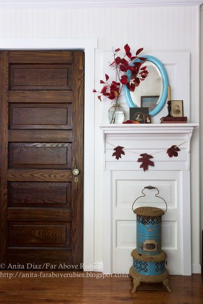 doors mantle upcycle fall, doors, fireplaces mantels They used an old door and attached a shelf for the mantle and painted it. Cute idea