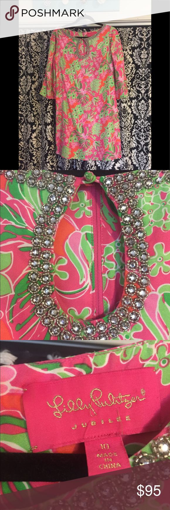 Lilly Pulitzer Vintage dress I think every beach going pool loving girl should own a Lilly Pulitzer. This is not the average cotton resort fare, this is a blinged out vintage classic pink and green embellished silk dress. Fully lined, 3/4 length bell sleeves, falls at are above knee depending on height. Size 10. IMO Lilly normally runs to a lean petite frame, but this dress is a solid 10. Tiny flaw pictured where rhinestone trim is missing absolutely unnoticeable unless you're looking for…