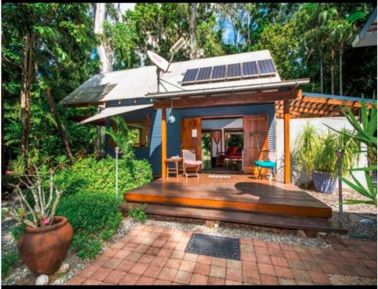in Cow Bay, AU. A beautiful space designed with the rain forest in mind. Open living allowing for natural light and our guests to be amongst nature in comfort. Guests can plunge in the fresh water stream on site or stroll to the beach, soul fuel at its best.