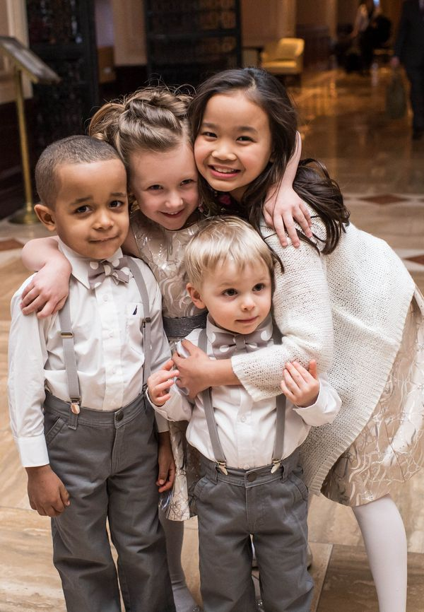 wedding  outfits so cute. grey and white bow ties and metalic silver flower girls dresses. via:the wedding project.