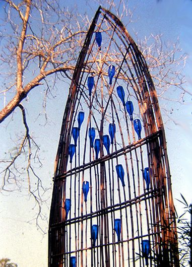 Upcycled from branches and glass bottles.