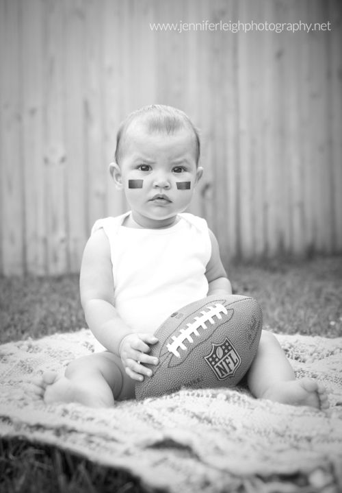 First Football Season for Baby {Georgia Baby Portrait Photographer} - Professional photographer and new mom, Jennifer Tacbas, dressed up her daughter for a football stylized shoot to celebrate her baby's first football season. Enjoy these pictures, and let them inspire you to take your own football themed baby portraits!