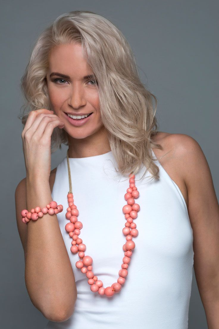Sea Flower necklace - Coral. Our chic single-strand wooden Sea Flower necklace looks stunning worn day or night. Large wooden beads are strung together to create a necklace that is lightweight and elegant. It comes in three shades; natural, coral and aquarelle and each has a matching bracelet. It has been handmade and is on an adjustable cord, so it can be worn at any length. http://www.lucyandalice.com.au
