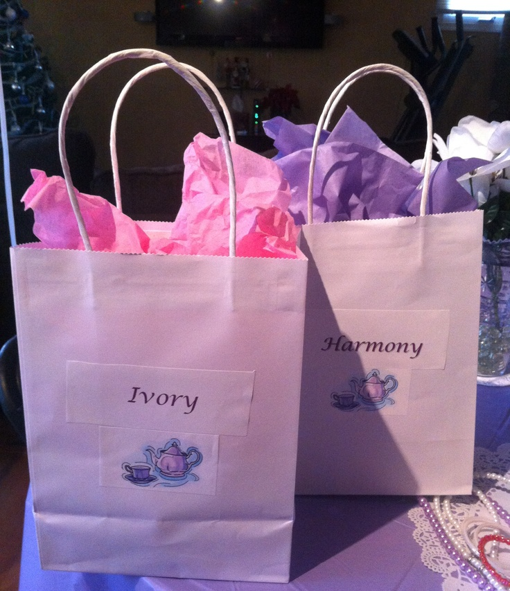 Personalized Gift Bags.        Mini tea set, take home cupcake, candy, party favors, and balloons.  Gift bags and tissue are from Dollar Tree.  I printed the names and teapots from my home computer.