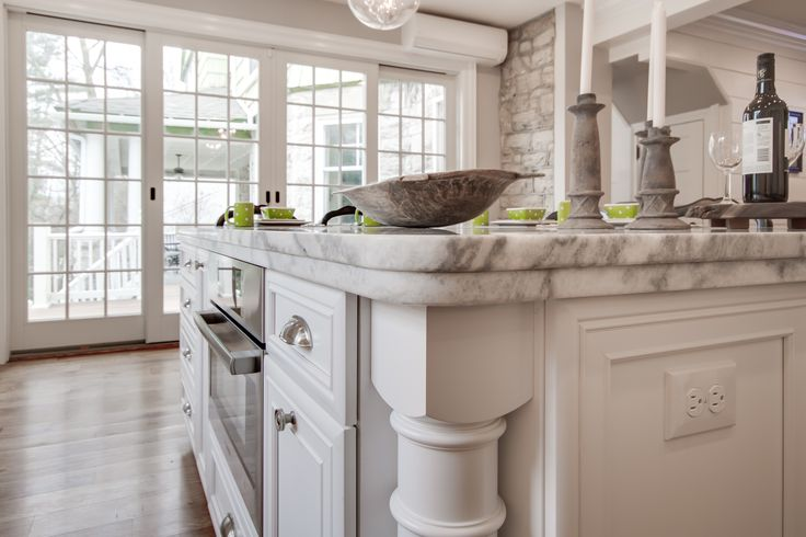 Mont Blanc honed quartzite countertop with white cabinets. The island has a laminated build-up edge profile for added thickness. Kitchen by Stoneshop from Cherry Hill, NJ.