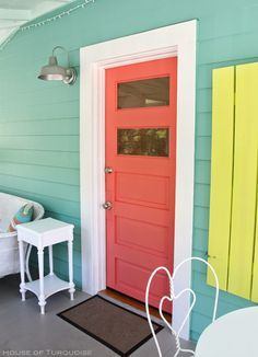 Exterior paint color: Hummingbird Blue by Glidden Door paint color: Coral Reef by Sherwin-Williams Shutters: Citron by Behr House of Turquoise