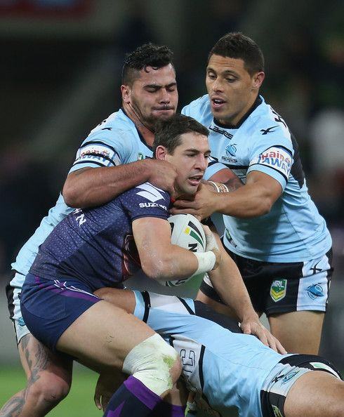 Billy Slater of the Storm is tackled during the round 13 NRL match between the Melbourne Storm and the Cronulla Sharks at AAMI Park on June 9, 2013 in Melbourne, Australia. http://footyboys.com