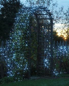 Magical nights cape - install solar powered string lights over an arbor and fence... or add outdoor lights and turn on when desired