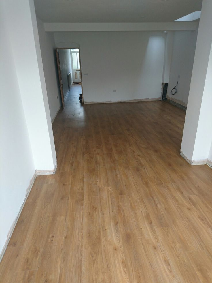 Amtico Spacia Traditional Oak flooring in new extension and running through to existing mid terrace house hallway to expand the feeling of space.