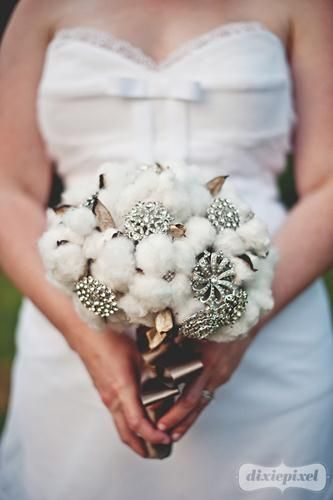 Whimsical Gatherings created this cotton and brooch bouquet for the bride wearing a southern-style wedding dress. It can be copied for a flowerless arrangement at any party.