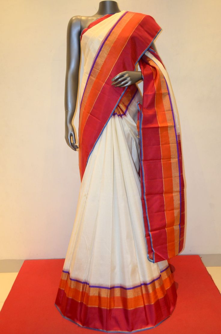 Kanjeevaram Classic Cream White Silk Saree With Traditional Zari Contrast Double Border Product Code: AB210814 Online Shopping: http://www.janardhanasilk.com/index.php?route=product/product&search=AB210814&description=true&product_id=3705