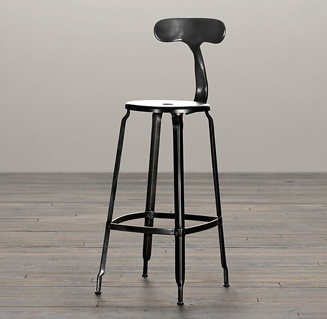 Popularized in 21st-century French factories, this industrial-inspired stool is completely crafted out of metal - from backrest to base.