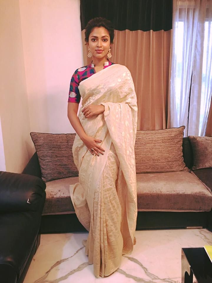 Amala Paul in a pearl white banaras saree with checked multi colored blouse by Red Lotus