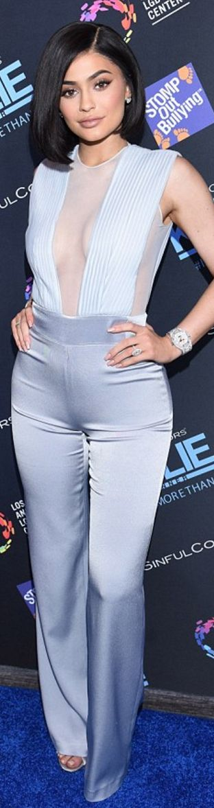 Kylie Jenner: Jumpsuit – Galvan  Earrings – Harry Kotlar  Bracelet – Hearts On Fire  Shoes – Gianvito Rossi