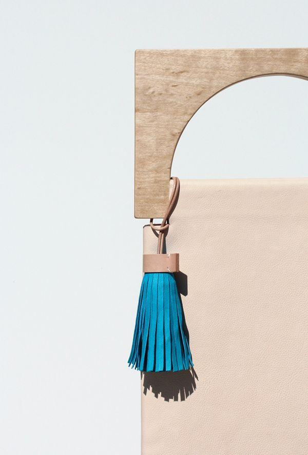 Wood. Leather. Bag. Designer. Artist. Inspire. Make. Interesting. Mod. Different. Structural. Fun. Tassel.