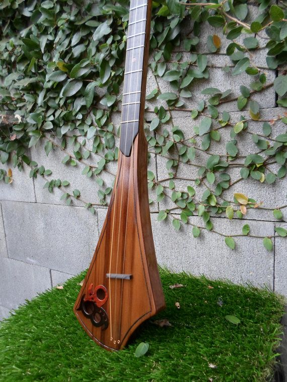 Call it what you will.. Dulcitar, dulcijo, rock it stick, pickin stick, strum stick or just plain dulcimer. This is the most fun you will have playing an instrument. Easy to learn, NO wrong notes and simple to carry around and store.    This is a special edition version.. Made with Tazmanian Black wood, Old growth redwood soundboard and Ebony finger board. Custom sound hole overlay with ebony and bloodwood. Measures 33 long by 5 1/2 wide which makes it easy to take with you wherever you go…