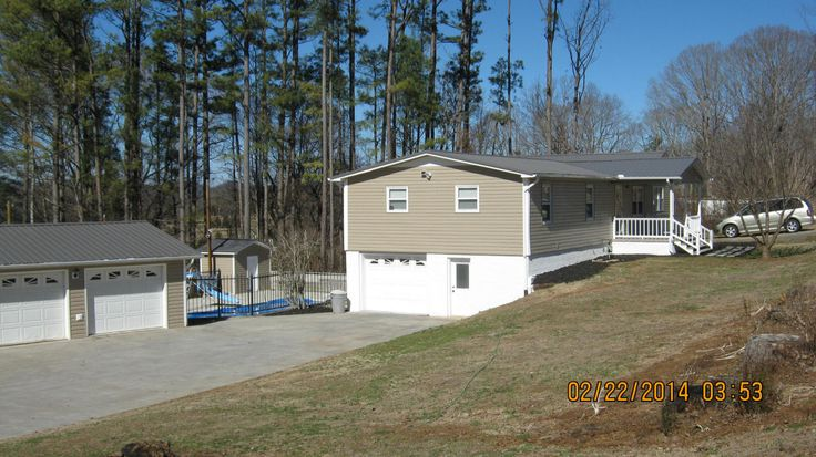 PENDING!!!!!!     Basement Ranch,Residential, Traditional - Madisonville, TN Newly renovated large family size home w. 2 car detached garage. New vinyl siding, insulated windows and doors. high end fixtures and lighting. Master could be on main level, has laundry room on main level and basement. huge great room as well as formal livingroom. Complete new kitchen including cabinets. get ready to enjoy 18x36 inground pool. Beautiful decor and paint. Must see property to appreciate.