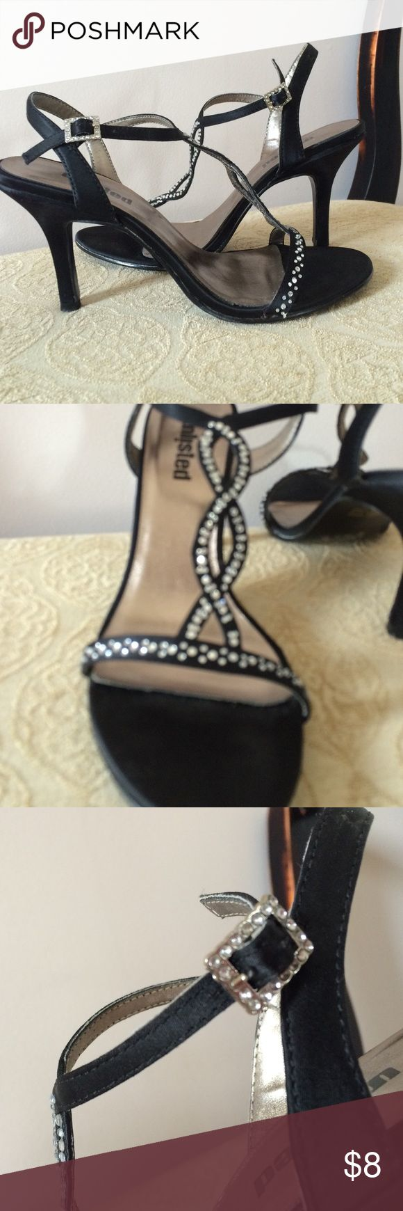 Worn but still very pretty dress heel. Great shape Shoe Department black heels with crystal embellishments. The lining is starting to come up a little at the ball but it's minor. Great deal. Shoes Heels