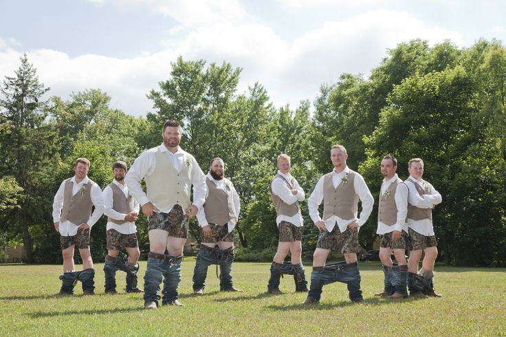 Groomsmen showing off their camo boxers!