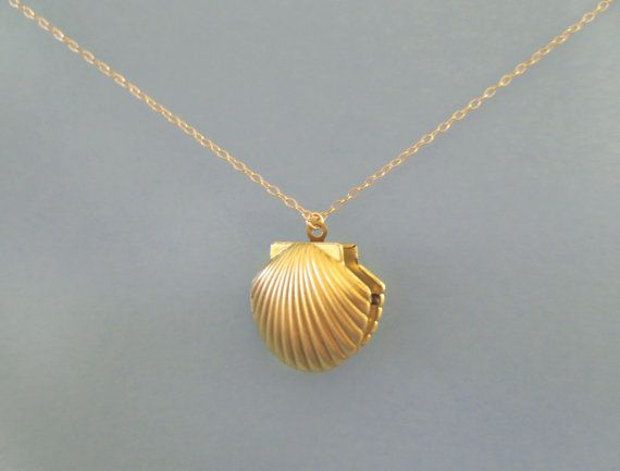 Hey, I found this really awesome Etsy listing at https://www.etsy.com/listing/154676913/mermaid-shell-locket-gold-necklace