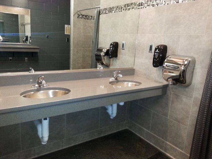 Sleek design for locker rooms at the REC Center. Designed by Jerilyn Horn at Building Materials in Ft. Madison, IA.
