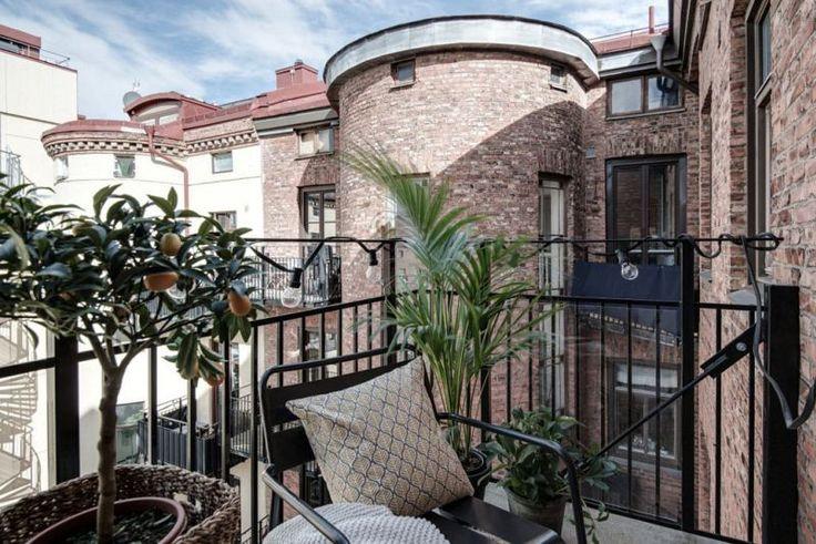 Swedish apartment with dark floor styled by Emma Hos