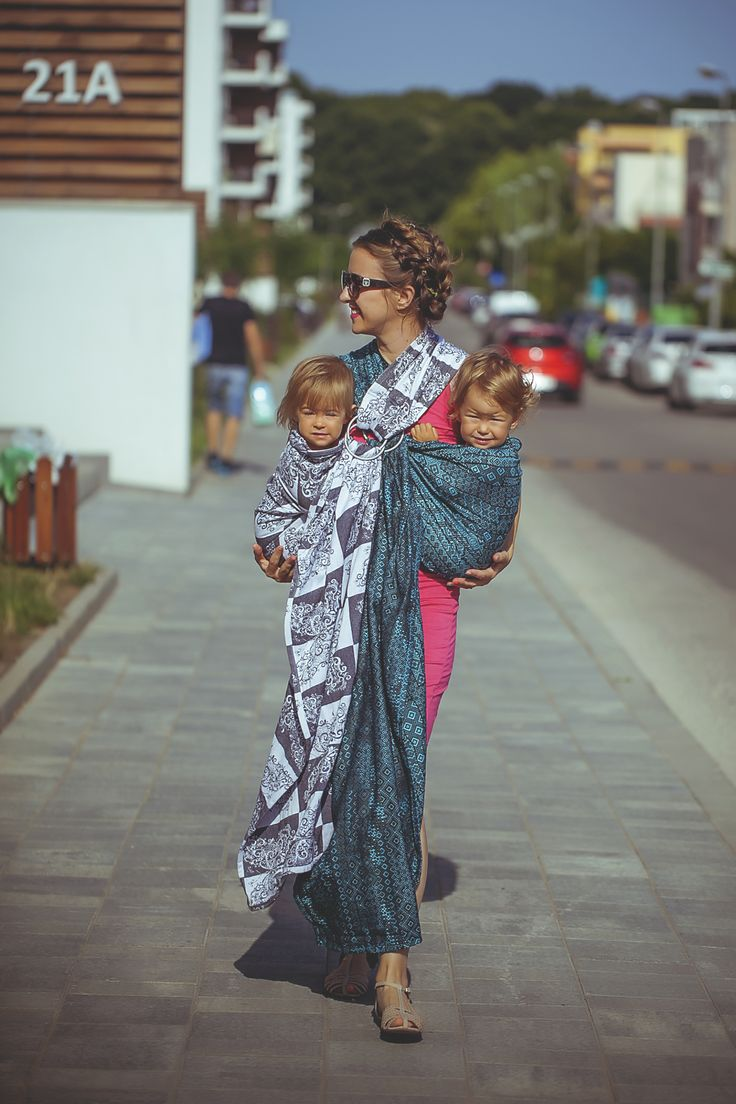 Ring sling tandem babywearing.  Check my blog for more ideas.