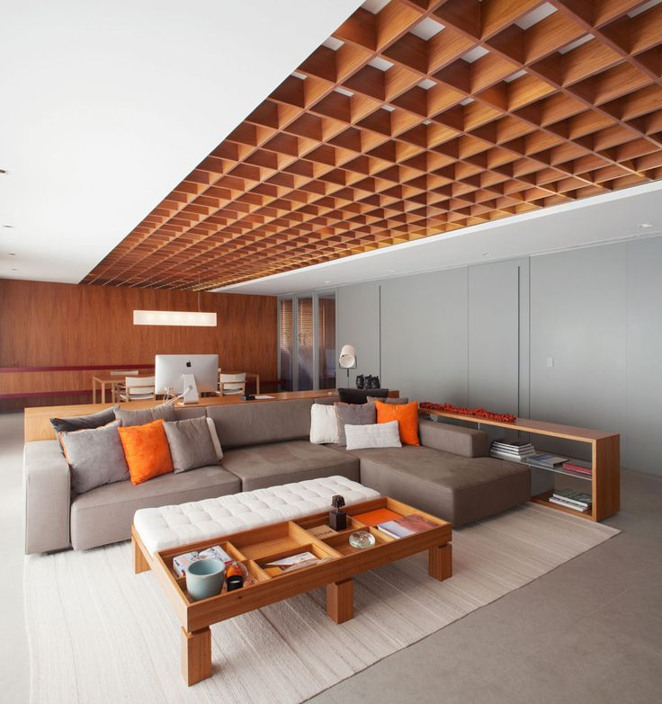 Perkins+Will created in this apartment a sophisticated, and at the same time comfortable, space, fulfilling in this way the wishes of the residents-to-be. This apartment located in São Paulo, Brazil was remodeled in 2015, with wood as its principal element, giving it sobriety and elegance. The ceiling is covered with a wooden grill that runs through the entire space and gives the home an uncommon and unique look. The furniture,..