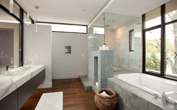 Дизайн ванной комнаты с душевой кабиной в сером цвете.
