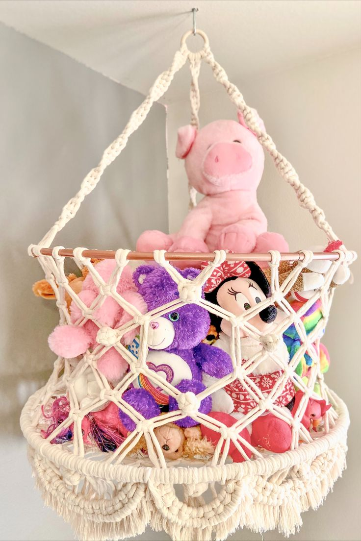This beautiful handmade hanging basket is PERFECT to keep stuffed animals in your baby's nursery, kids room, or playroom! It would also be a beautiful addition to a boho living room to store blankets or pillows! It hangs up high to clear up floor space and make the room seem much less cluttered. It has a larger opening in the front for easy access and a gorgeous fringe that lines the bottom to really make this a statement piece.