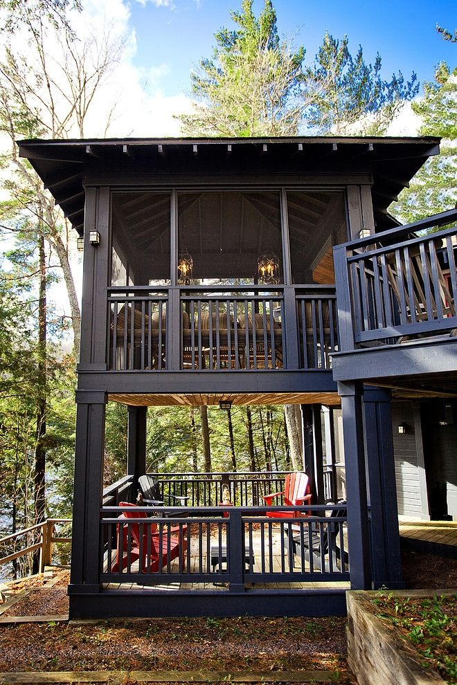 Now I know what a darkish (off-black)) porch would look like ...  When ur surrounded by trees, light stain goes out the window... Unless u like pressure washing green algae every year (& Allstate just luvvs to use that as a cancellation xcuse in FL)....  Like the different design of off-set balusters....