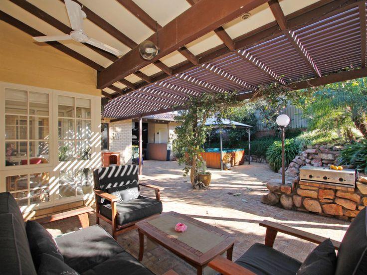 Indoor-outdoor outdoor living design with bbq area & decorative lighting using slate - Outdoor Living Photo 1547365