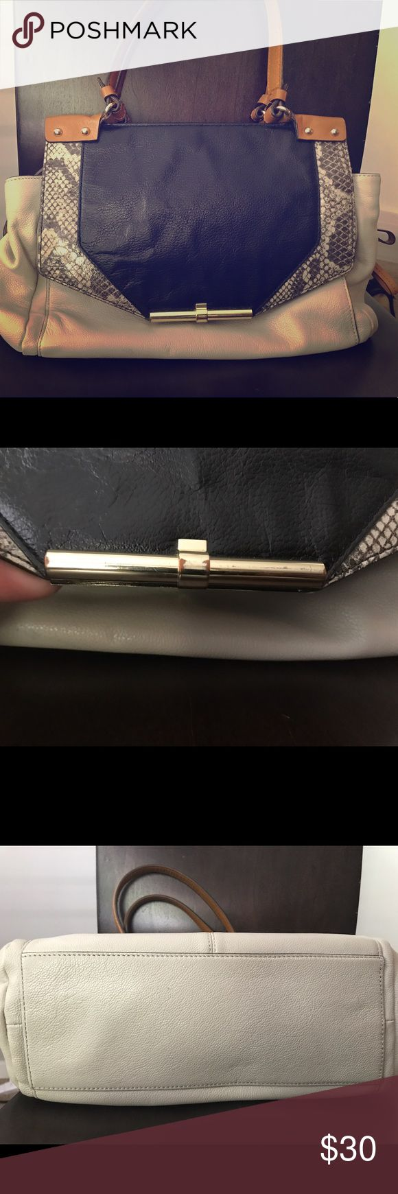 Neutral shoulder bag. Great for work, church, play Used shoulder bag with minimal wear. Clasp has some fading and so does metallic bar Vince Camuto Bags Shoulder Bags