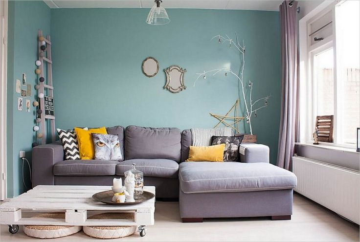 Fashionable Feminine Living Room Filled With Lovely Flea Market Finds Featuring Puffy Grey Sofa Set With Yellow Cushions Also Rustic Barn Coffee Table And Blue Tosca Living Room Color Ideas | Trendy Feminine Living Room Design And Decor Ideas | vanelibg.com
