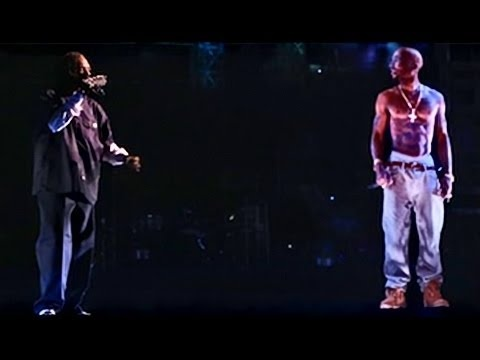Tupac Shakur performing with Snoop Dogg at Coachella 2012 and just got signed to Cash Money Records (YMCMB).
