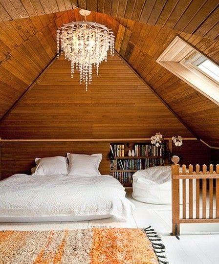 Paint the floors white, bed on floor, chandelier on ceiling, big rug, bean bag