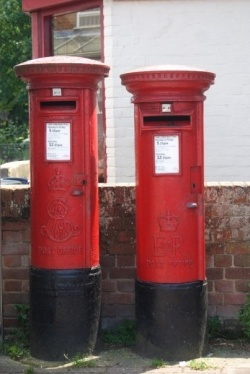 You might see them as just a place to post your letter, but British letter boxes come in many shapes and sizes and have a history that goes back over 150 years.    Letter boxes are seen in every city, town, village and hamlet in Britain but most people walk past them without giving them a second thought.    This is a very concise overview of some of the variety of letter boxes that can be seen in British streets today.    The picture shows two pillar boxes, in the centre of Hailsham Sussex…