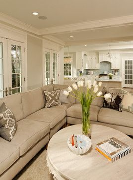 """Colors for the Living Room remodeling! (Ben Moore Gray Owl) opens to white kitchen (cabinets are custom BM Decorator's White). Trim is BM Snowfall White.  The sectional is by Lee Industries and is upholstered in """"Riva Dune"""" linen."""